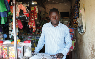 a man in a shop illuminated by off-grid solar
