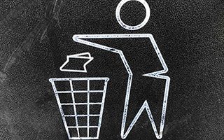 a symbol depicting a person throwing away trash into a bin