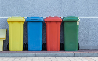 four recycling bins in different colours