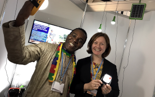 GOGLA Staff member with stakeholder at COP24