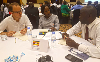 Partners in Kigali discussing at a round table